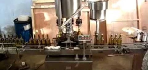Liquor Filling Line, Oil Filling Machine, ROPP Cap Sealing Machine, Sticker labelling machines