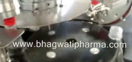 Rotary Screw Capping machine for PET Bottle.wmv