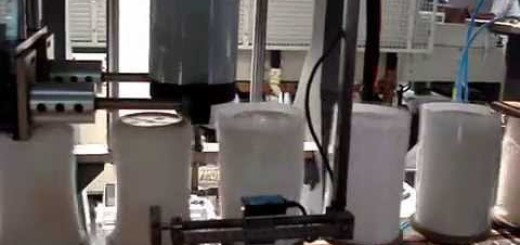 Shrink Sleeve Applicator with Rotating Jar Shrink Tunnel .wmv