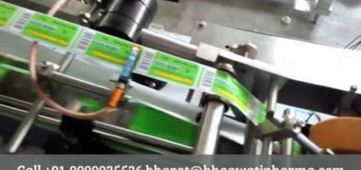 Top side labeling machine, top side sticker label applicator for plastic container
