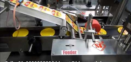 Top side sticker labeling machine for caps